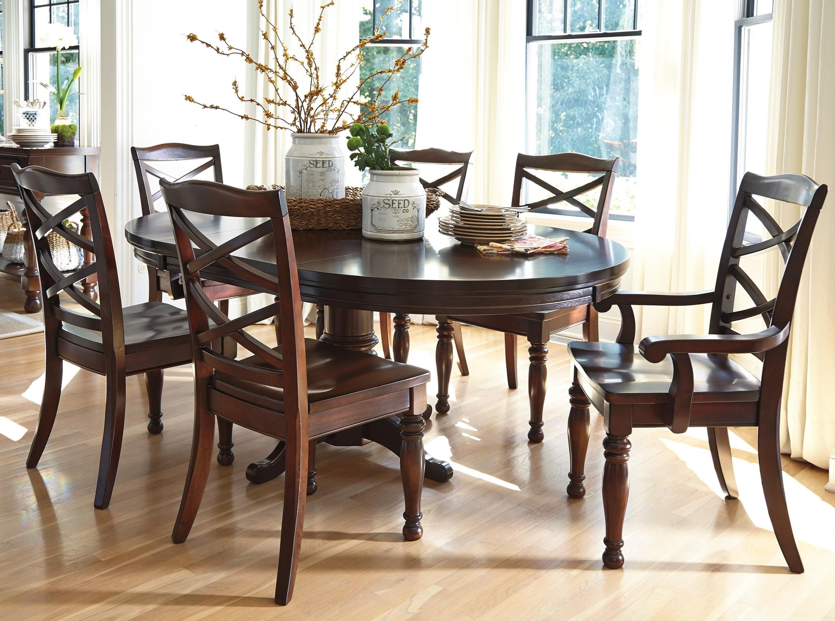 Ashley furniture porter 7 piece round dining table set for Ashley furniture dining table