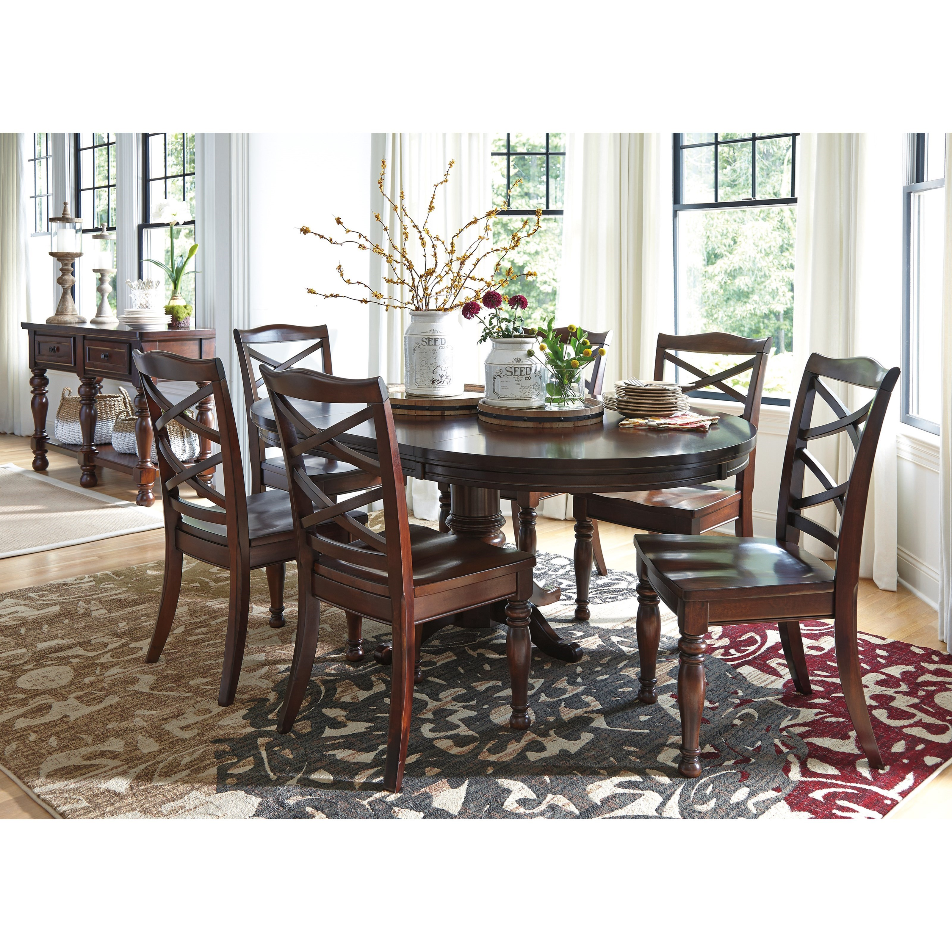 ashley furniture porter round dining room pedestal table with leaf pilgrim furniture city. Black Bedroom Furniture Sets. Home Design Ideas