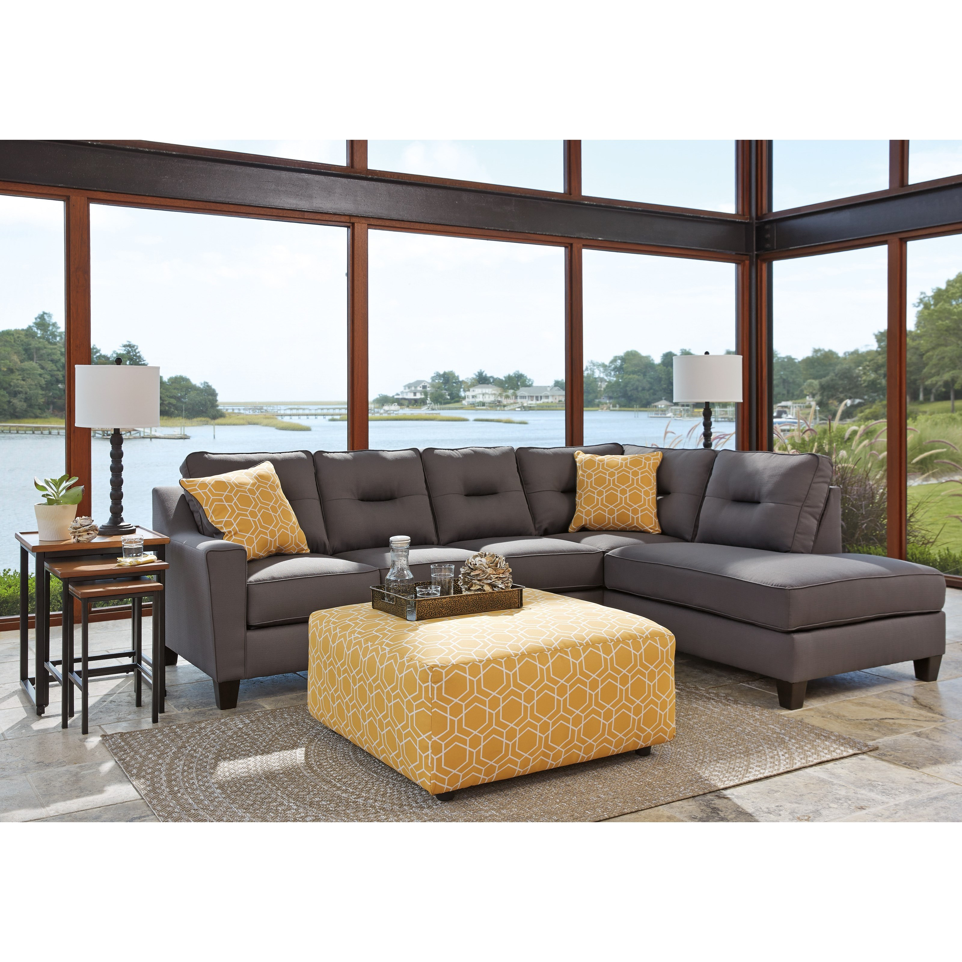 Benchcraft kirwin nuvella stationary living room group for Living room furniture groups