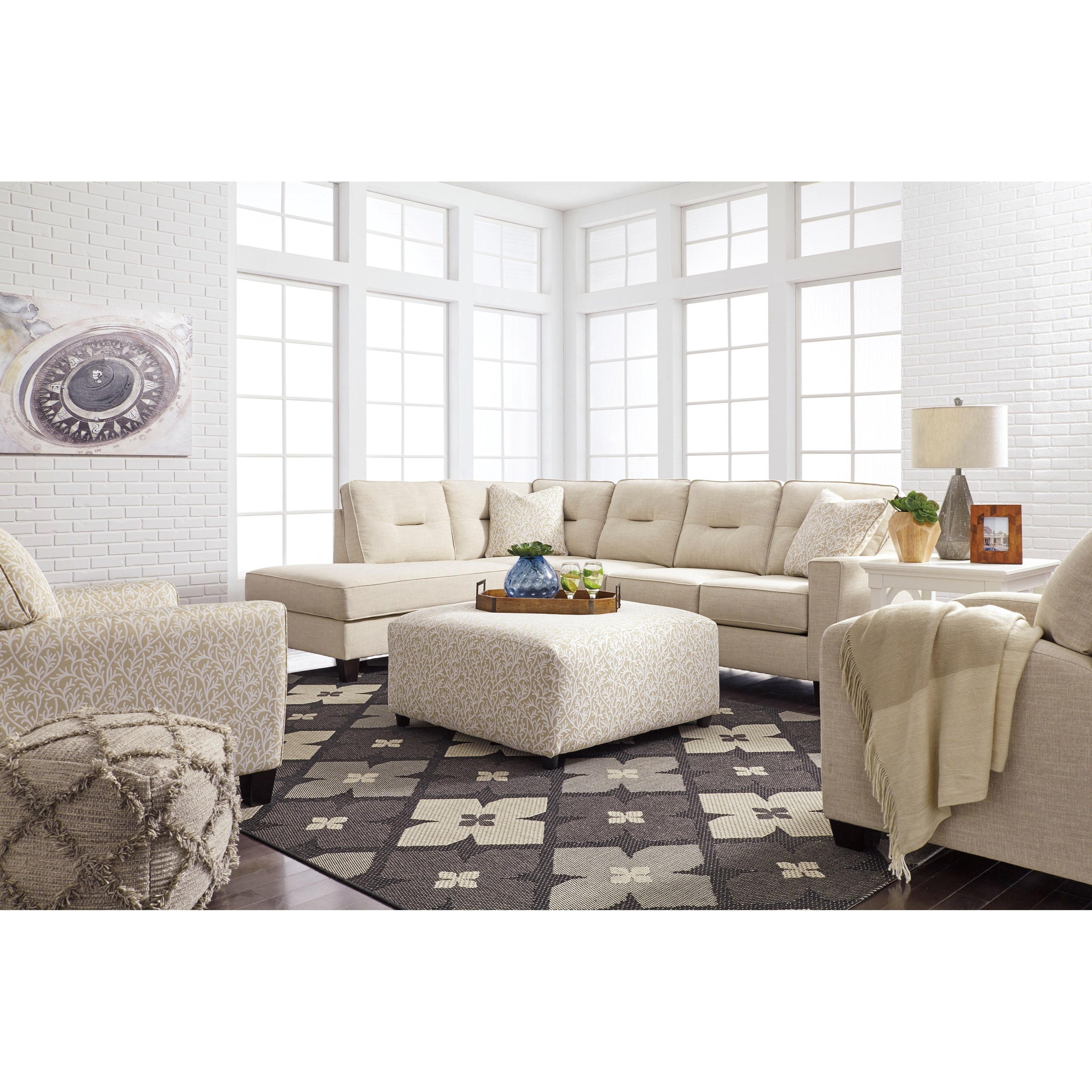 Benchcraft kirwin nuvella sectional with sleeper sofa for Divan vs chaise