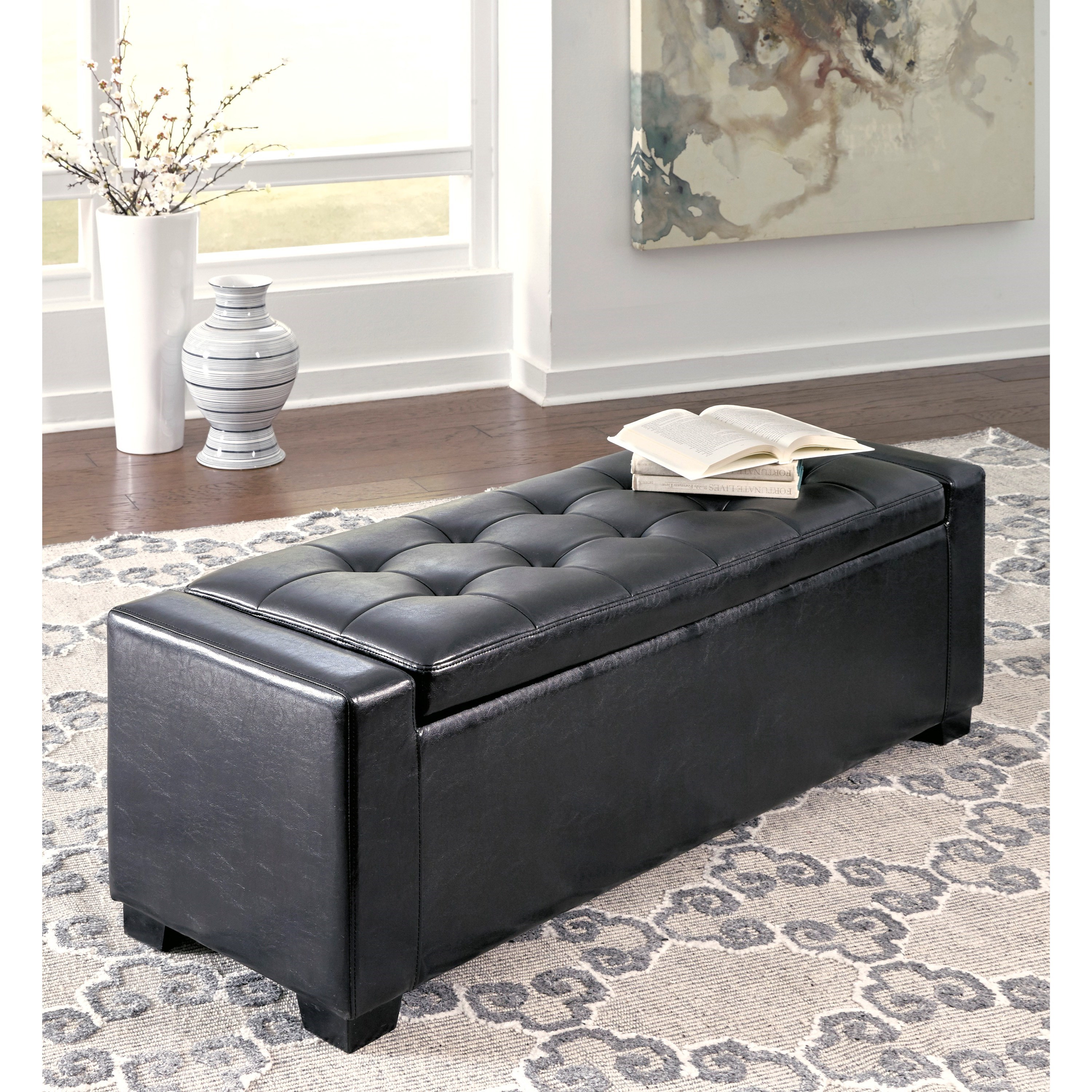 Ashley signature design benches upholstered storage bench in black faux leather with tufted for Living room bench with storage