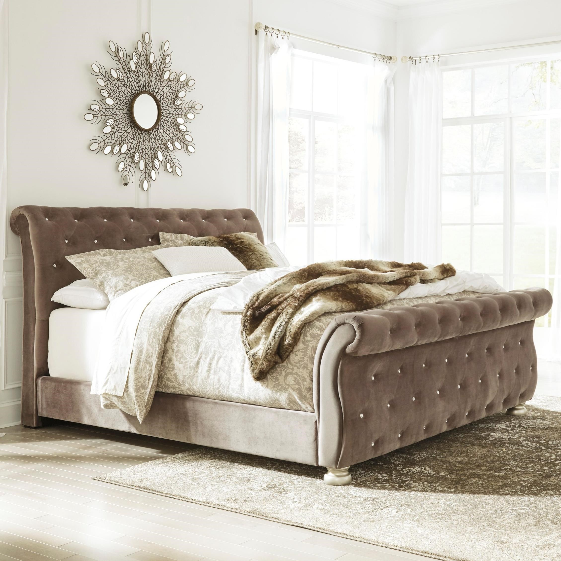 Signature design by ashley cassimore king upholstered sleigh bed with faux crystal tufting for Upholstered sleigh bedroom set