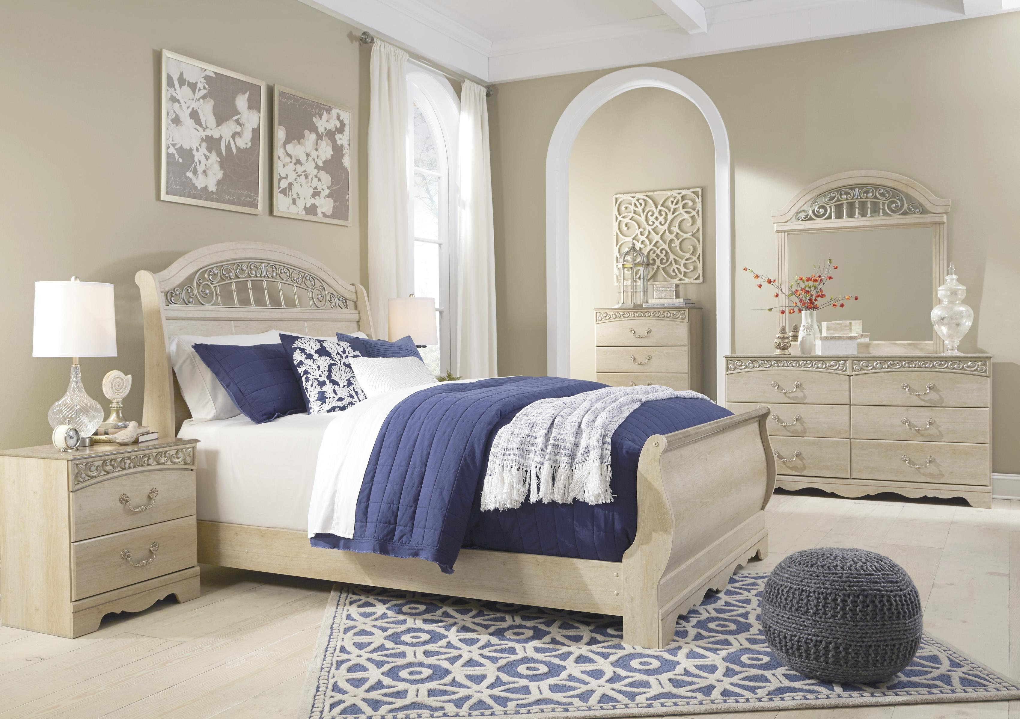 Signature design by ashley catalina traditional queen sleigh bed with metal fretwork miskelly for Ashley furniture sleigh bedroom set