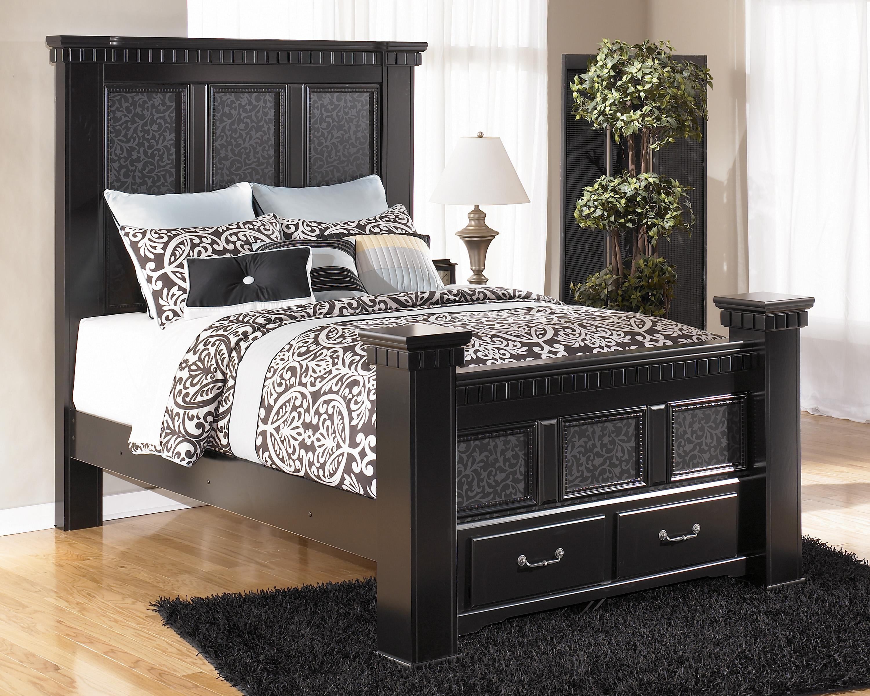signature design by ashley furniture cavallino queen mansion poster bed with storage footboard