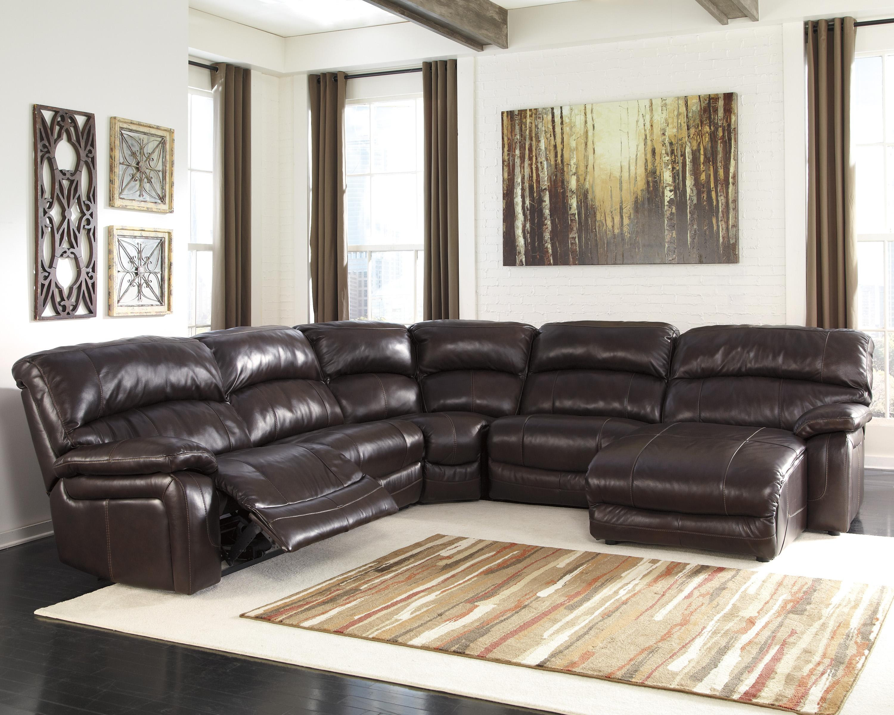 signature design by ashley damacio dark brown reclining sectional with right press back chaise. Black Bedroom Furniture Sets. Home Design Ideas