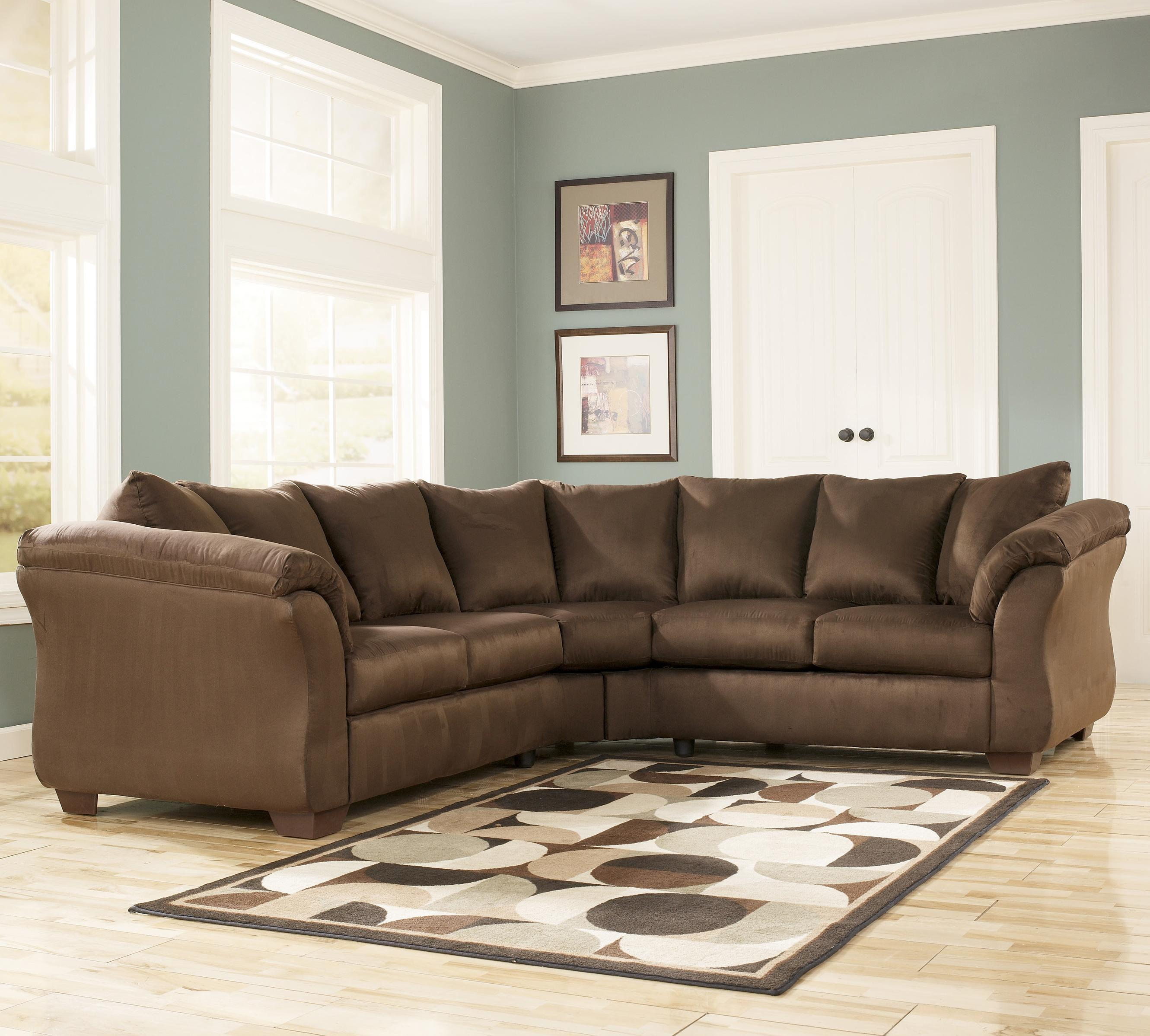 signature design by ashley darcy cafe contemporary sectional sofa with sweeping pillow arms. Black Bedroom Furniture Sets. Home Design Ideas