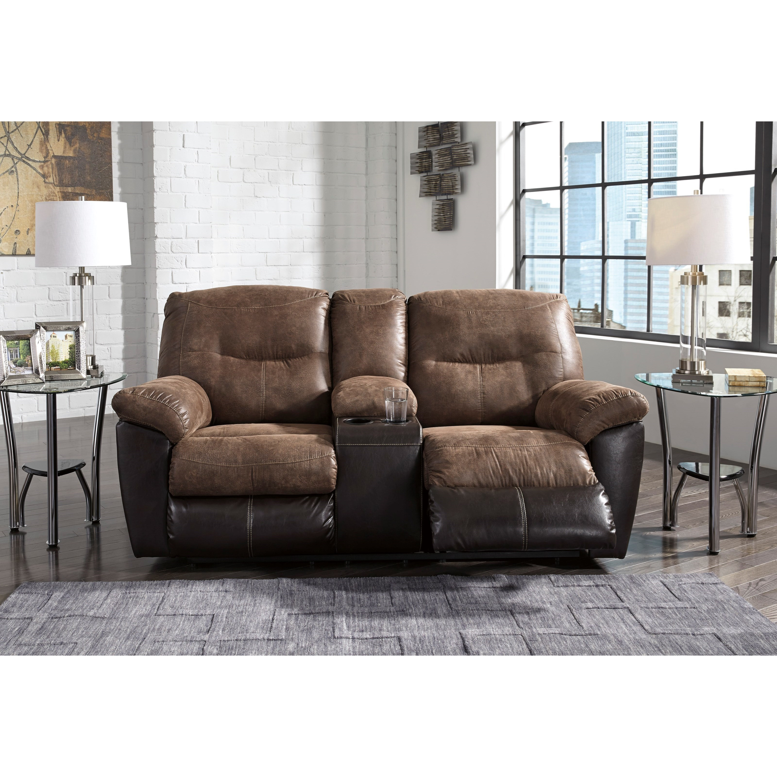 Ashley signature design follett two tone faux leather double reclining loveseat w console for Living room with two recliners