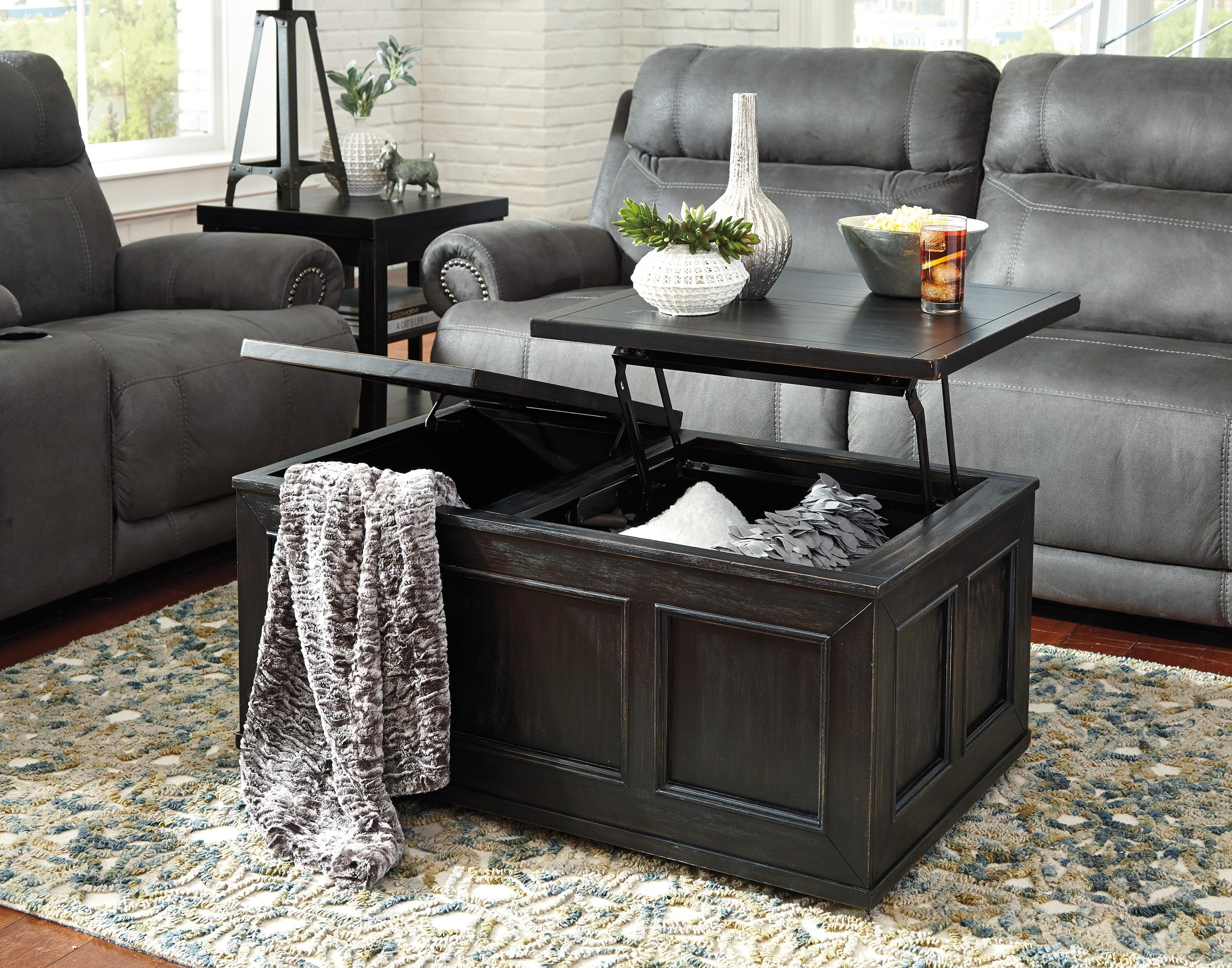 Signature design by ashley gavelston rustic distressed black trunk style lift top cocktail table Black lift top coffee tables
