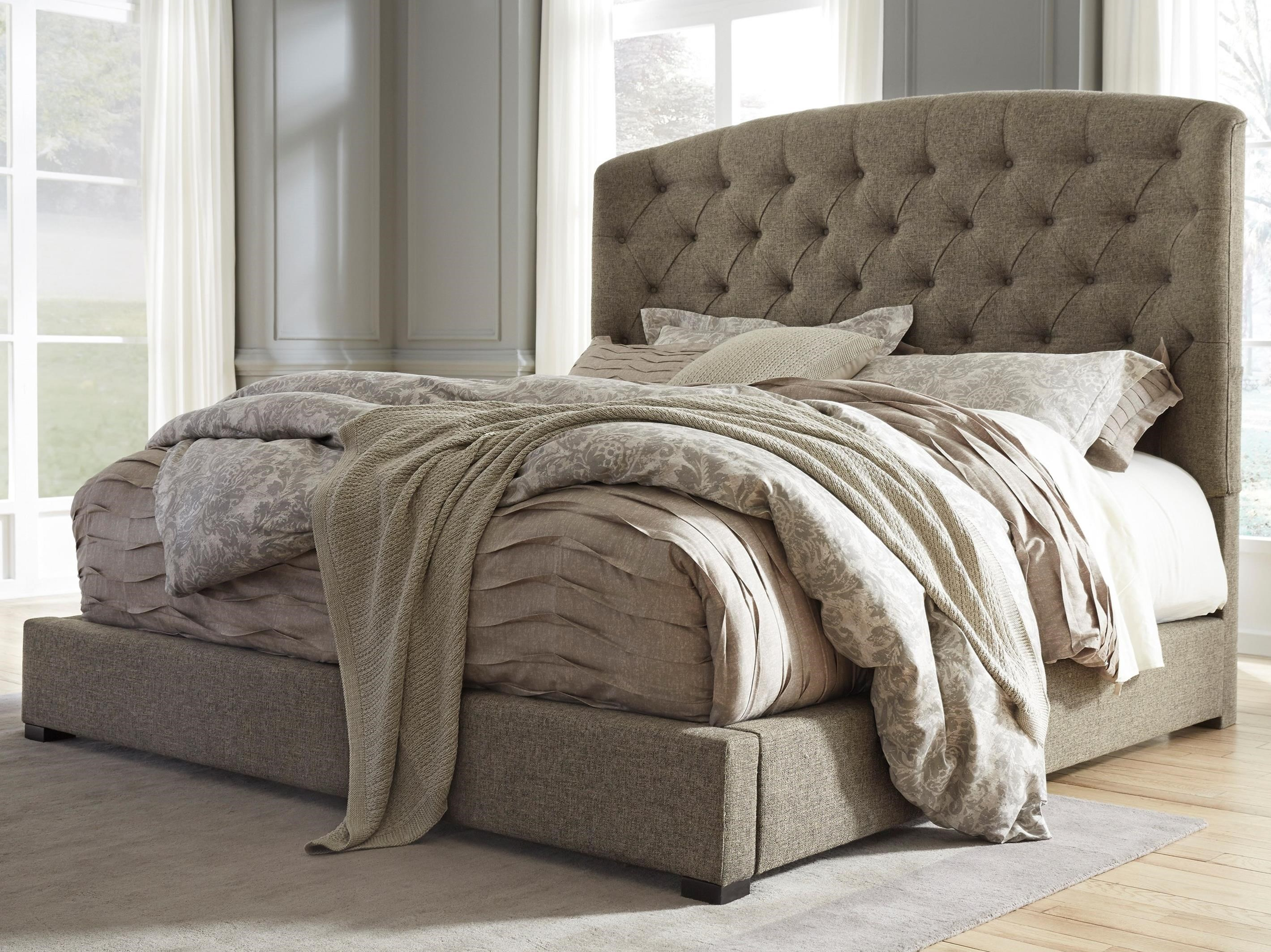 Signature design by ashley gerlane queen upholstered bed with arched tufted headboard and low Home furniture queen size bed