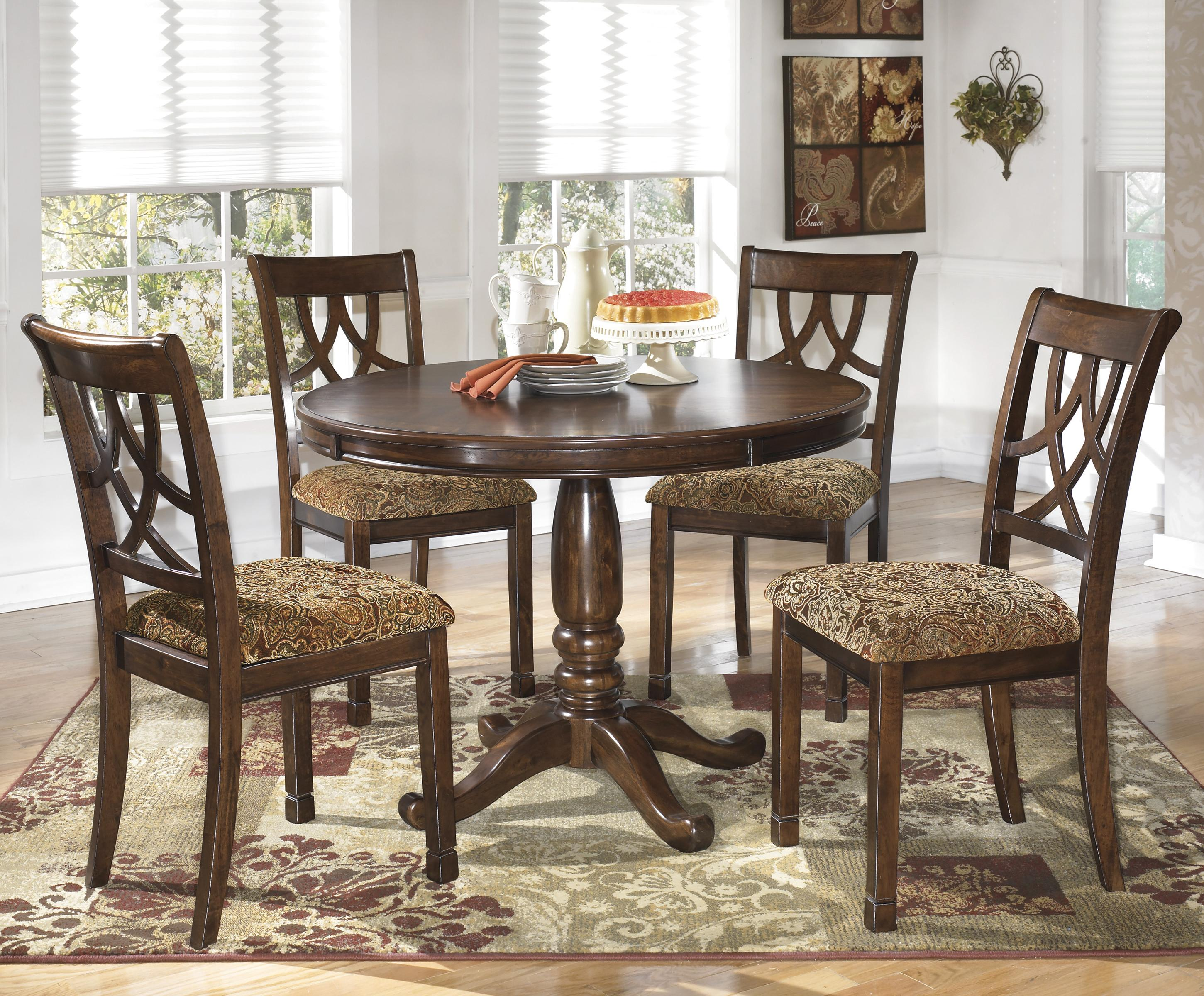 signature design by ashley leahlyn 5 piece cherry finish round dining table set value city. Black Bedroom Furniture Sets. Home Design Ideas