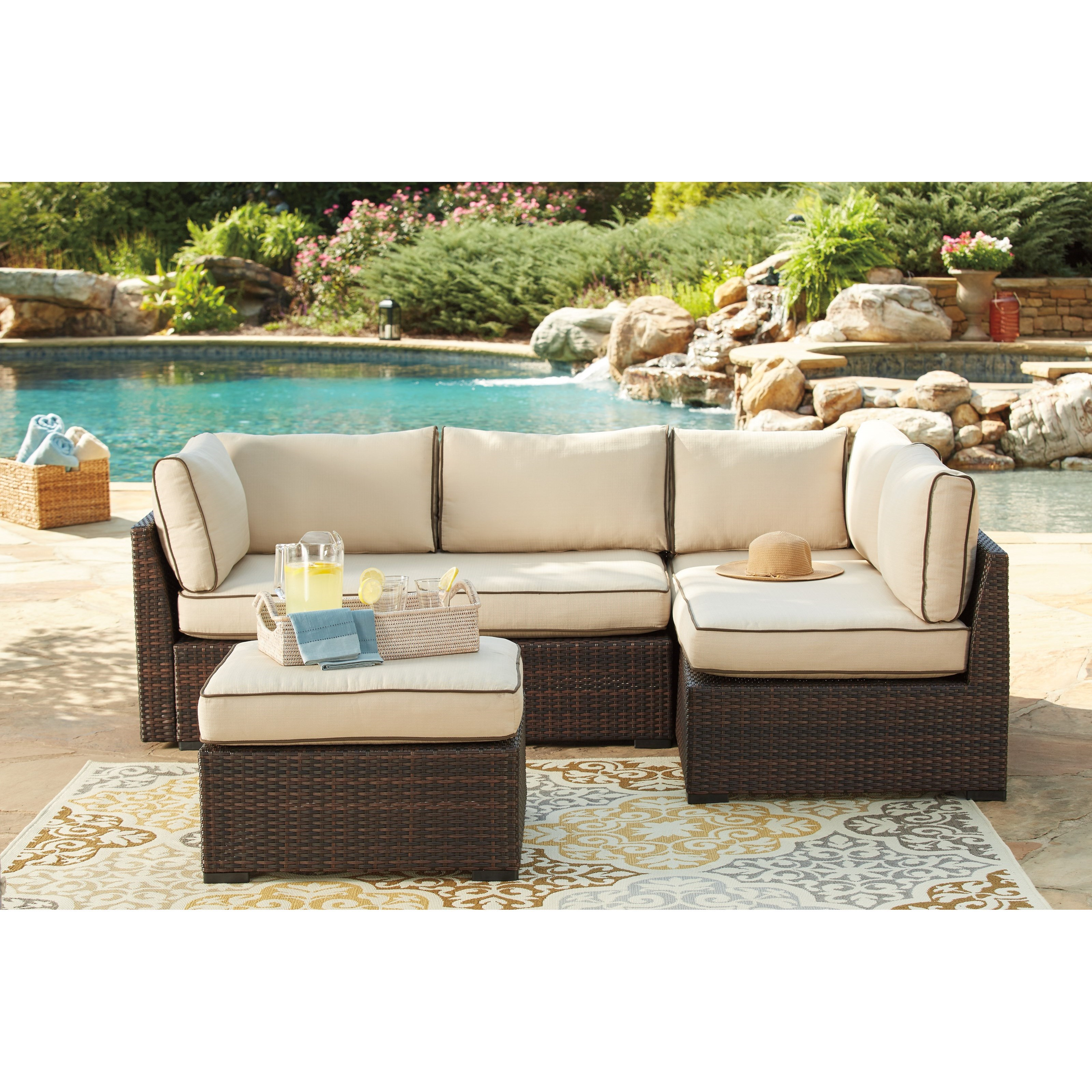ashley signature design loughran p300 070 outdoor sectional set with cocktail table dunk. Black Bedroom Furniture Sets. Home Design Ideas