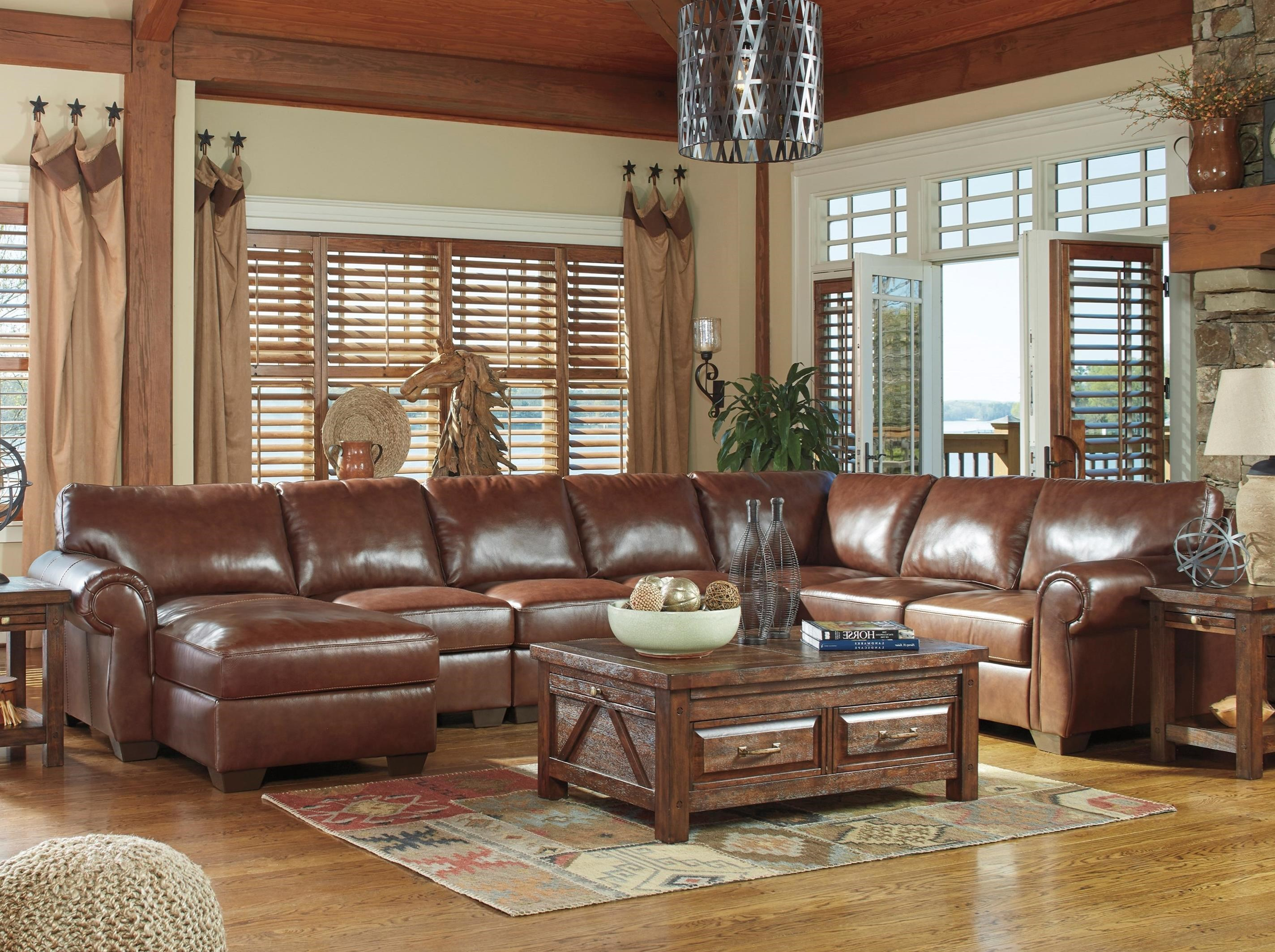 Signature design by ashley lugoro leather match 5 piece for 5 piece sectional sofa with chaise