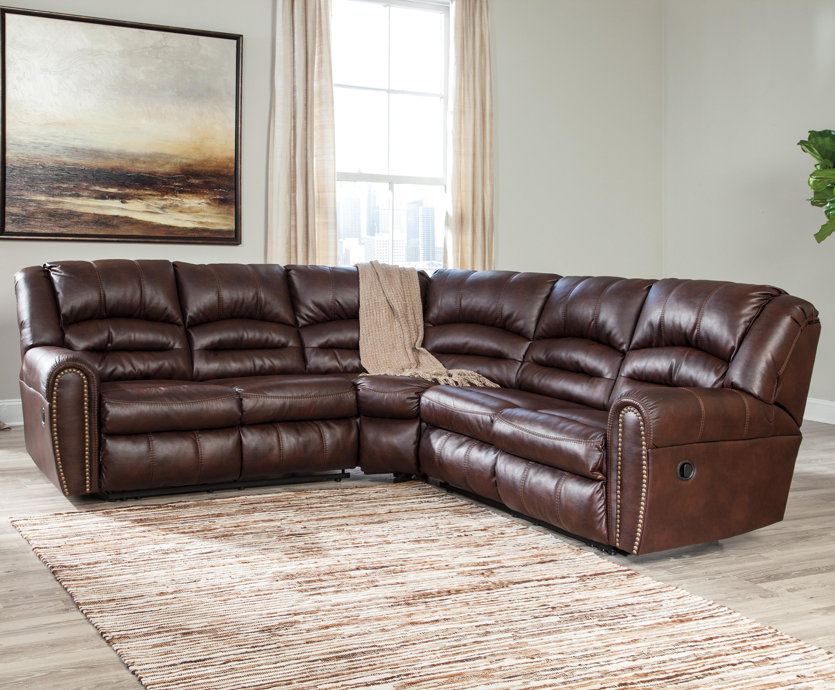 Signature design by ashley manzanola reclining sectional for Sectional sofas with nailhead trim