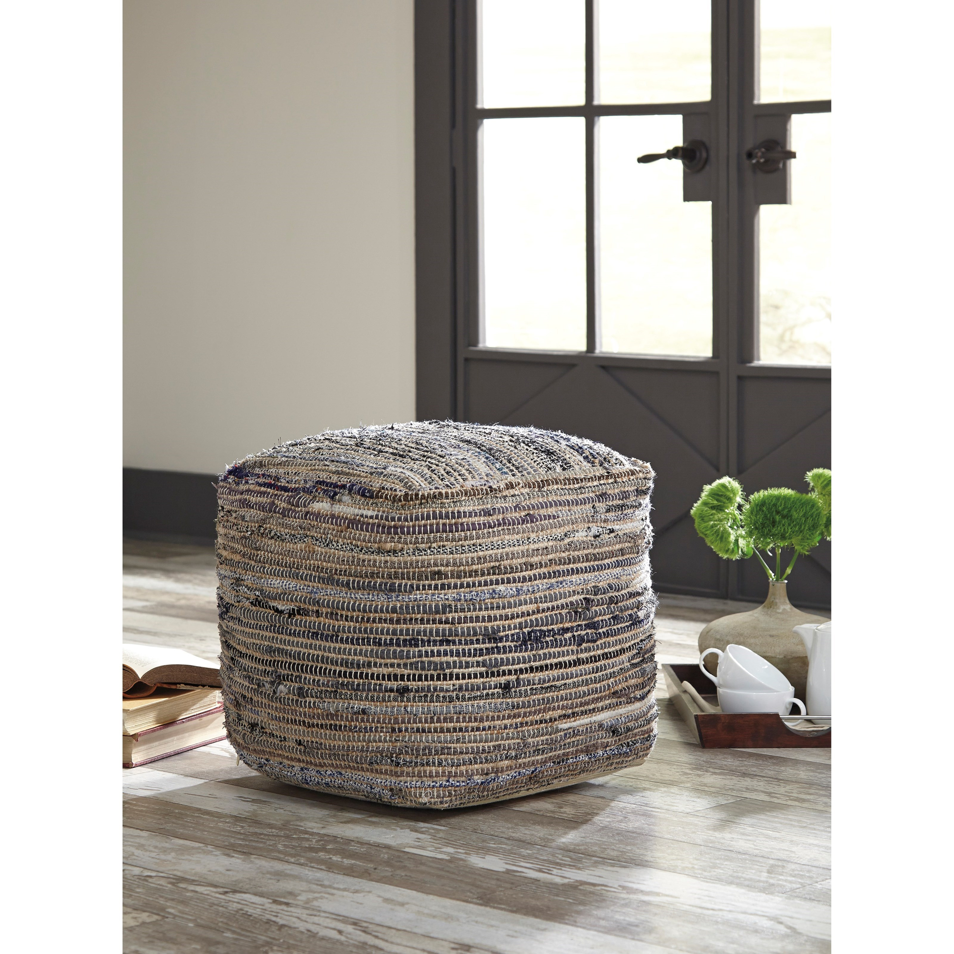 signature design by ashley poufs absalom natural pouf. Black Bedroom Furniture Sets. Home Design Ideas