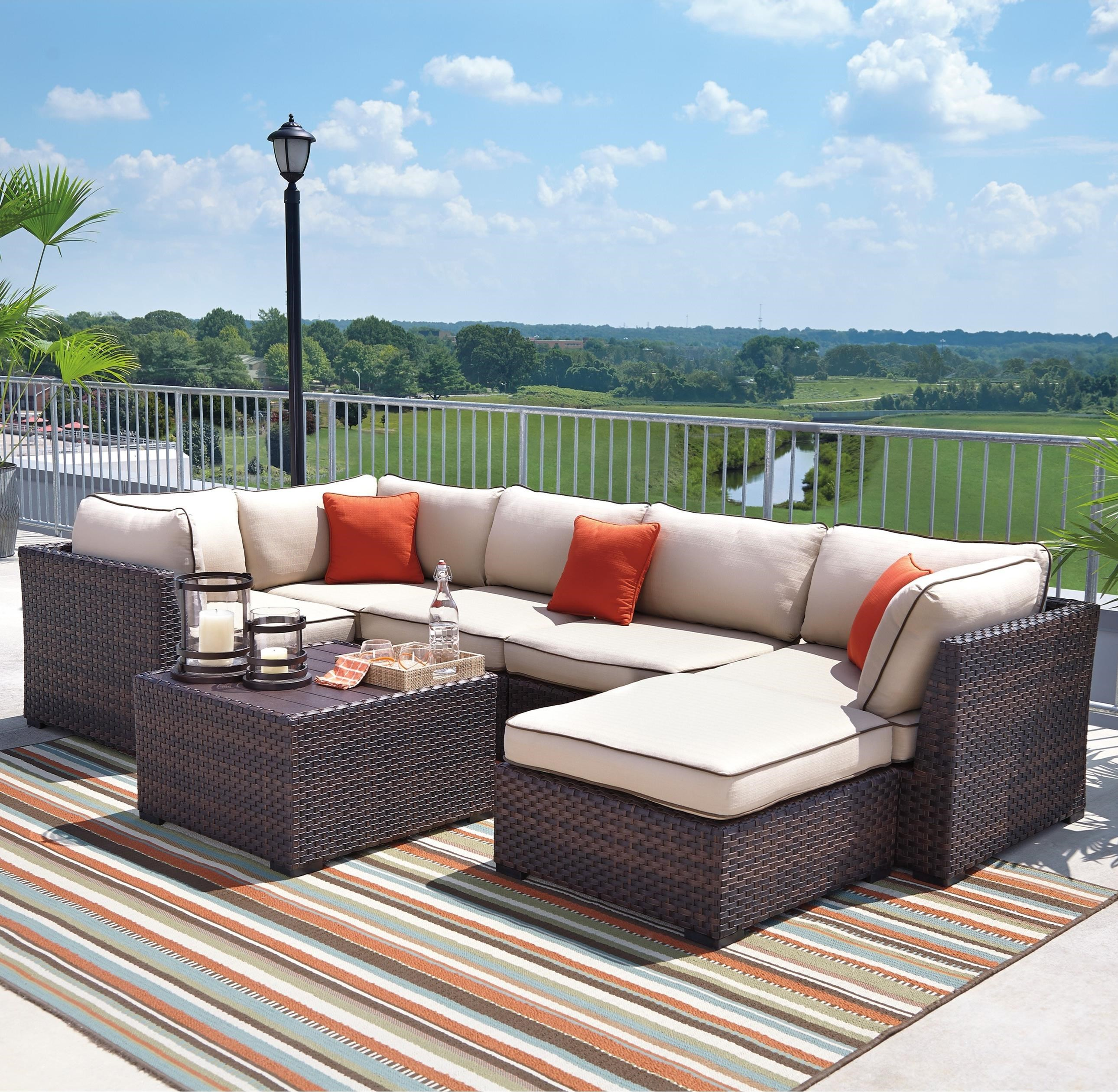 Signature design by ashley furniture renway outdoor for Small outdoor sofa