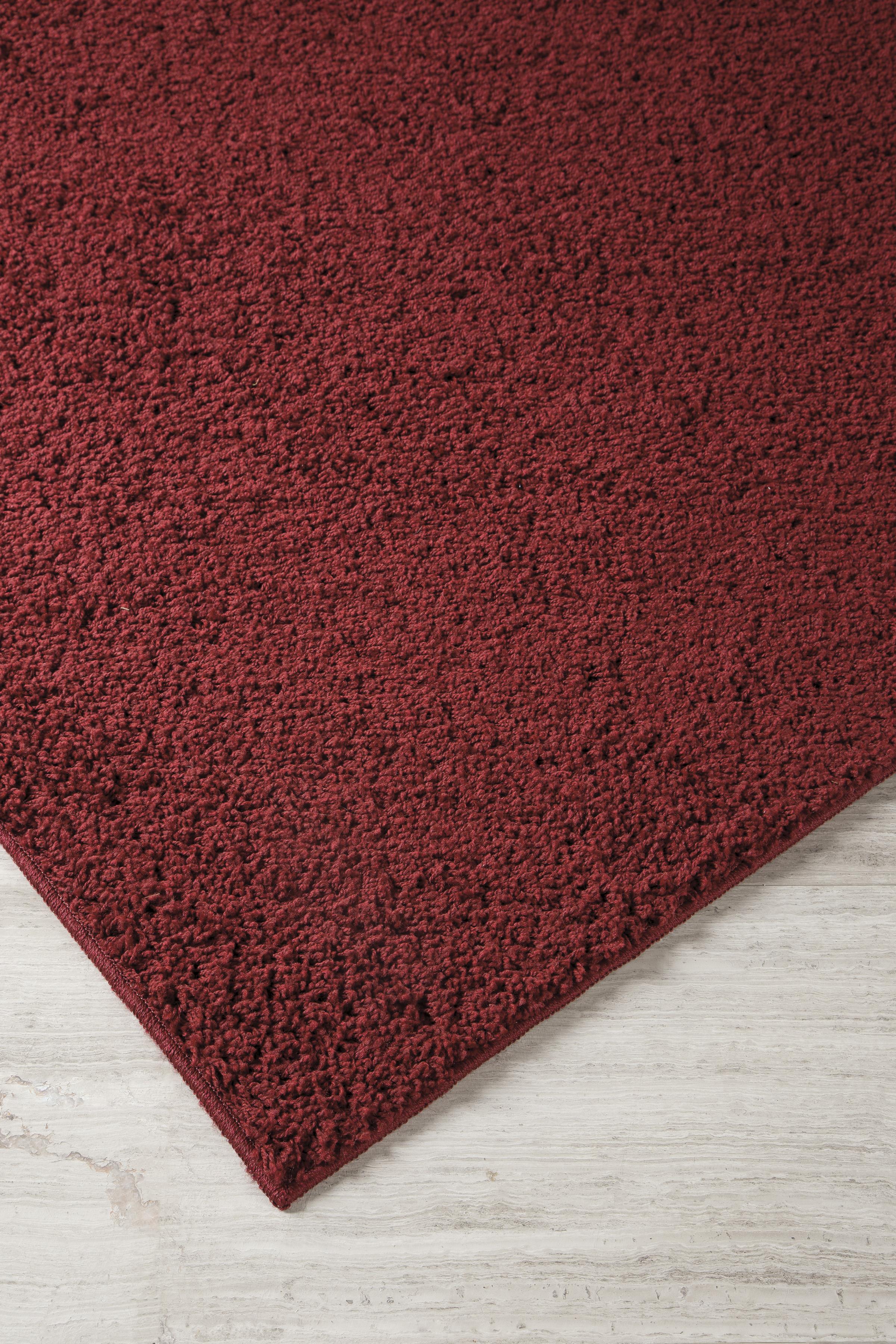 Signature design by ashley contemporary area rugs caci red for Red area rugs contemporary
