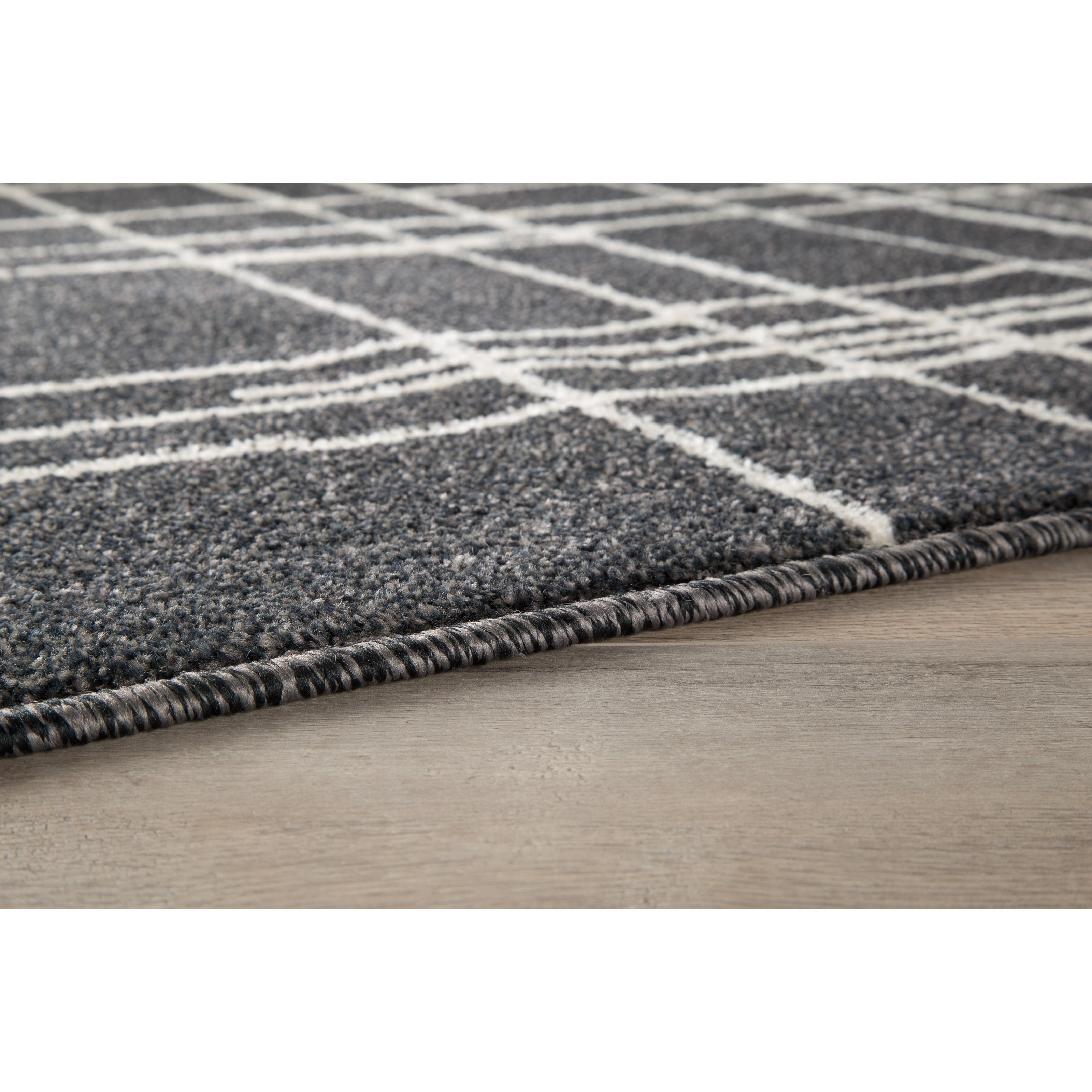 benchcraft contemporary area rugs jai black white medium rug virginia furniture market rugs. Black Bedroom Furniture Sets. Home Design Ideas