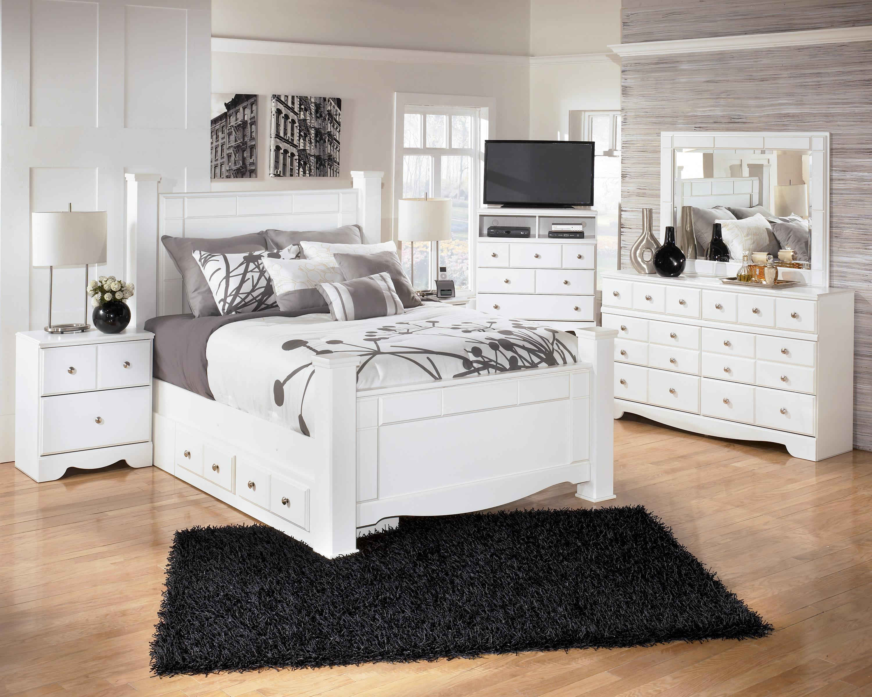 Signature design by ashley weeki queen poster bed with underbed storage del sol furniture Queen bedroom sets with underbed storage
