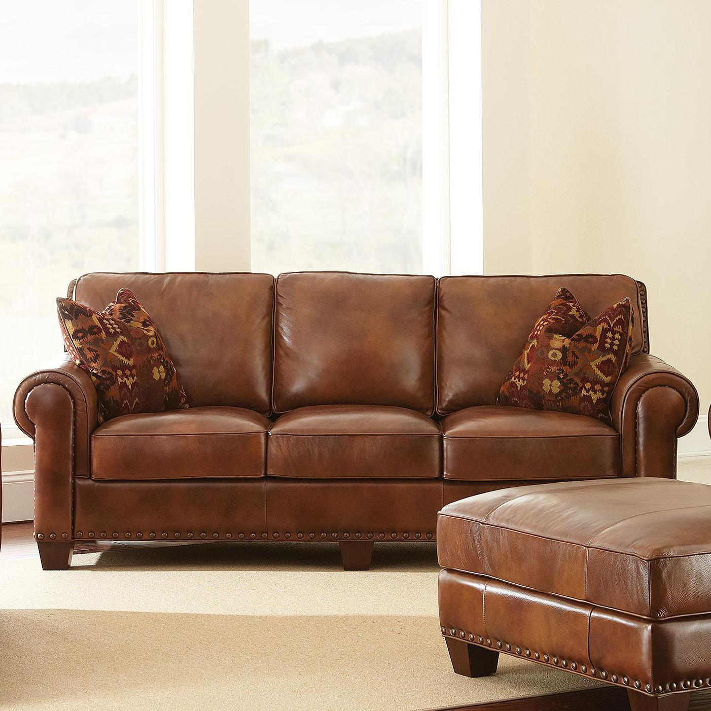 Steve silver silverado traditional sofa with nailhead trim for Traditional sofas and loveseats